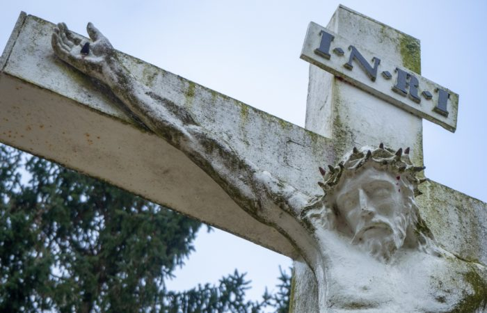 A large white wooden crucifix