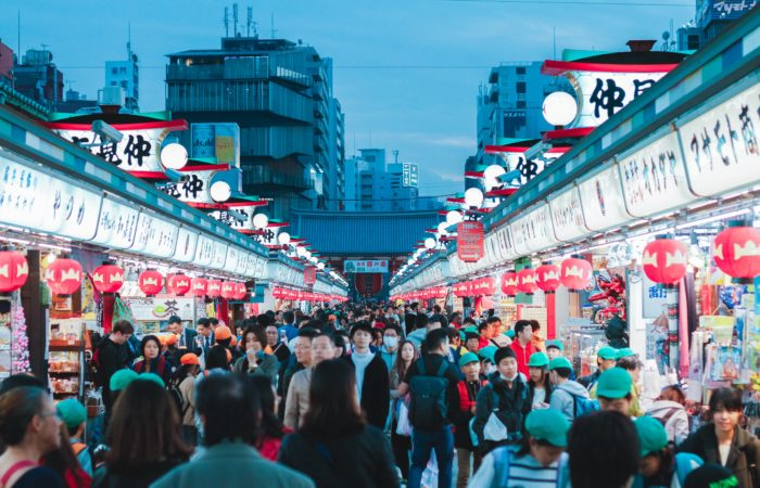 A crowd of people outside the Sensoji Temple, Tokyo, Asakusa, Japan, in the evening