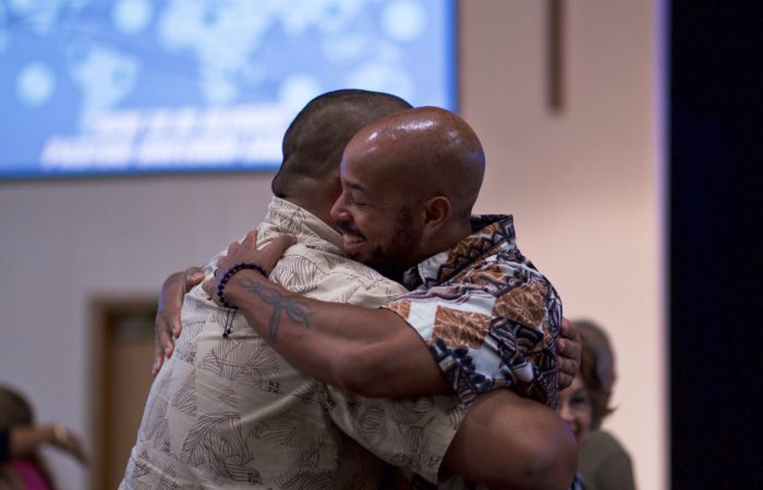 Two men hugging at church
