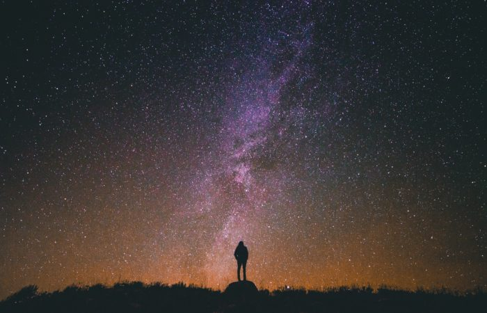 A man looking up at a star-filled sky