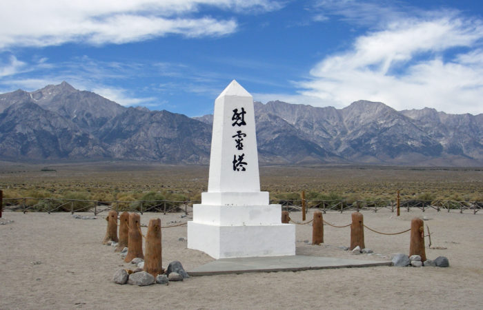 """Monument at Camp Manzanar in California with Japanese characters reading """"Soul Consoling Tower""""."""