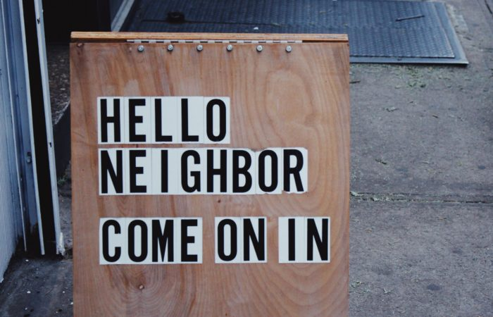 """A sign that says """"Hello Neighbor, Come on In"""""""