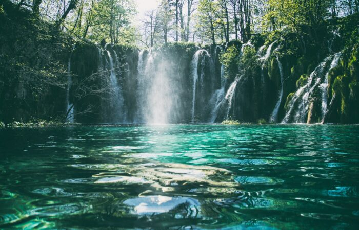 A beautiful green pool with a waterfall