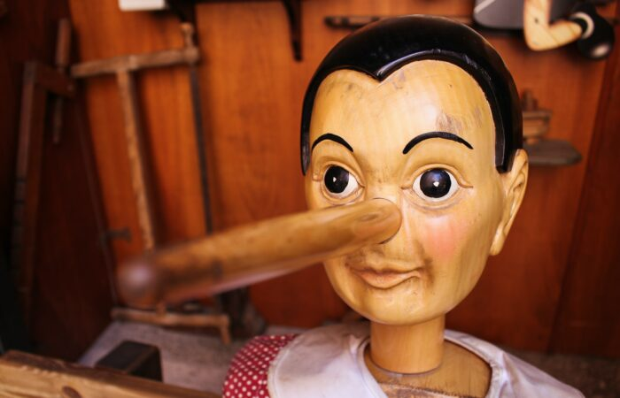 A wooden Pinocchio doll with a long nose