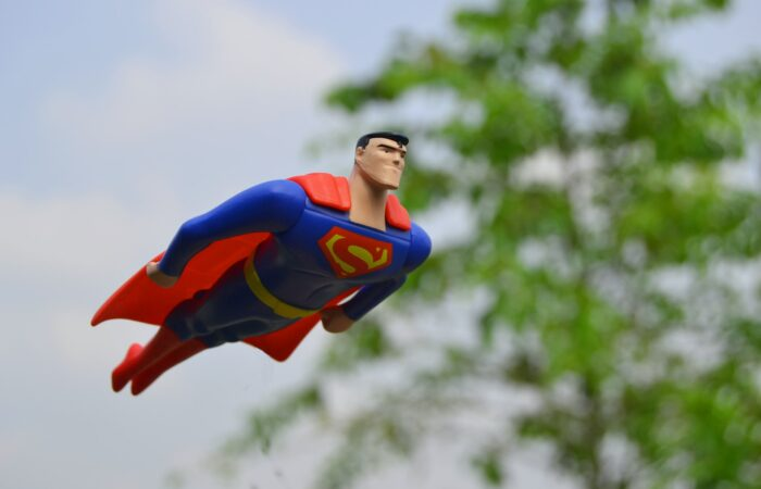 A Superman toy flying through the air