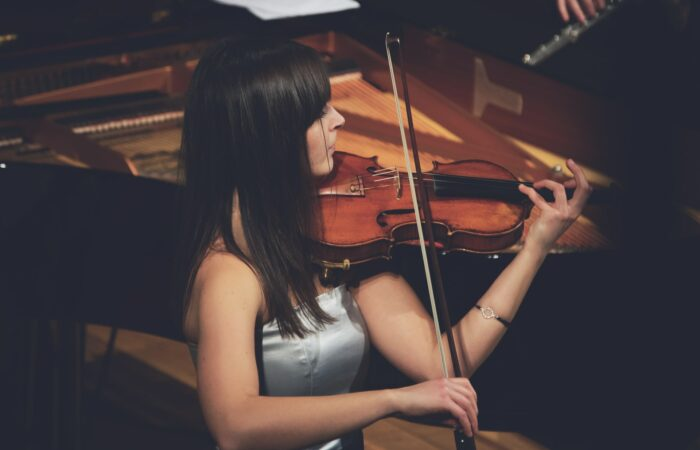 A young woman playing a violin