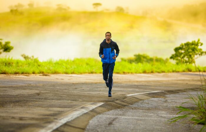 A young man jogging on an empty street